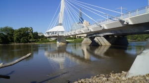 Esplanade Riel Bridge and the Human Rights Museum seen from the banks of the Red River.